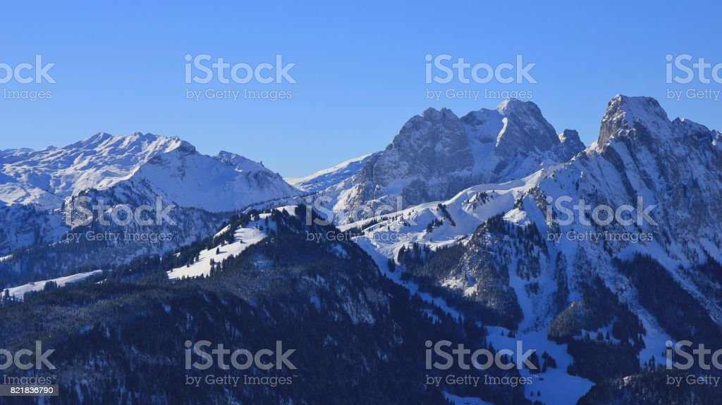 Snow covered mountains Gummfluh and Le Rubli, view from mount Rellerli. stock photo