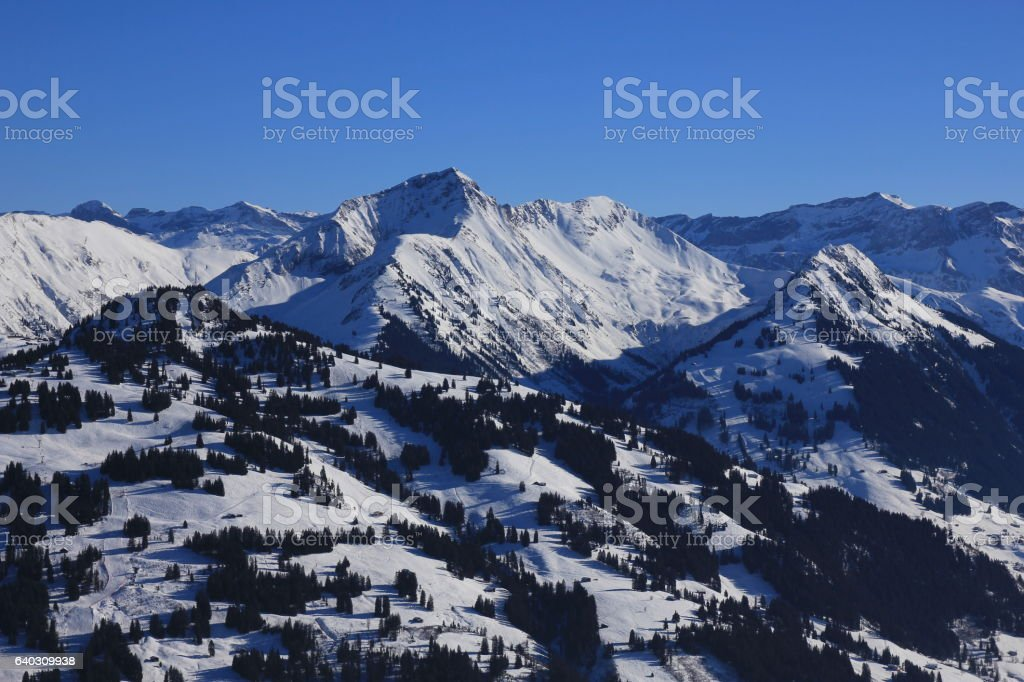 Snow covered mountains Hornberg, Giferspitz and Wasseregrat stock photo