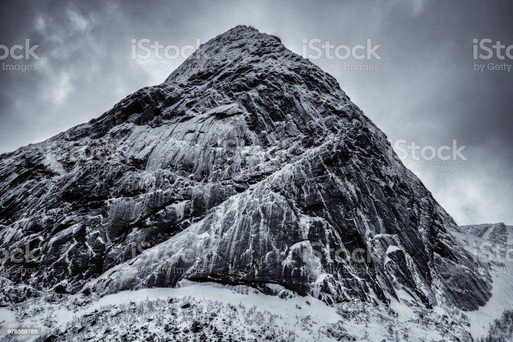 Snow covered mountains of Reine, Norway.  Lofoten Islands stock photo