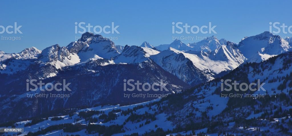 Snow covered mountains seen from mount Rellerli, Switzerland. stock photo