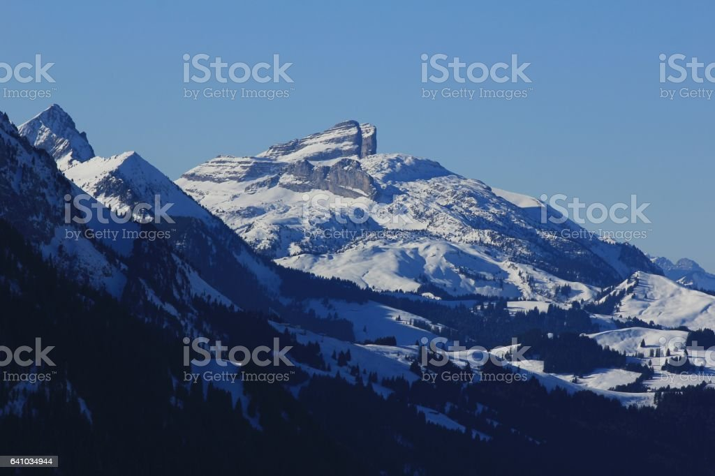 Snow covered mountains Tour d Ai and mount d Or stock photo