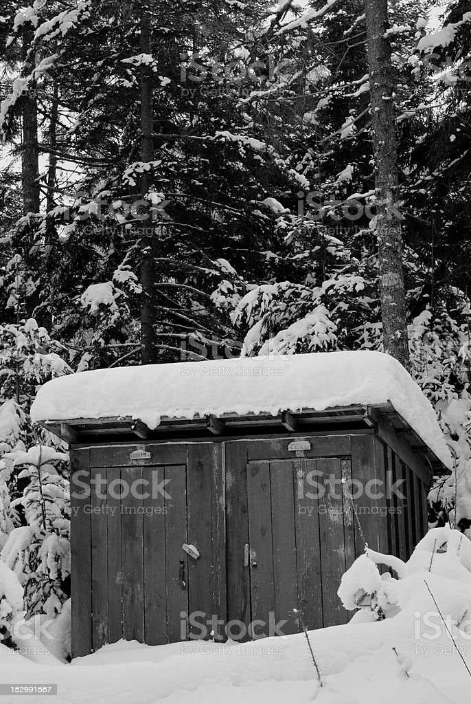Snow Covered Outhouse stock photo