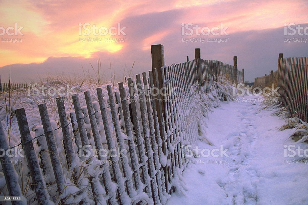 Snow Covered Picket Fence stock photo