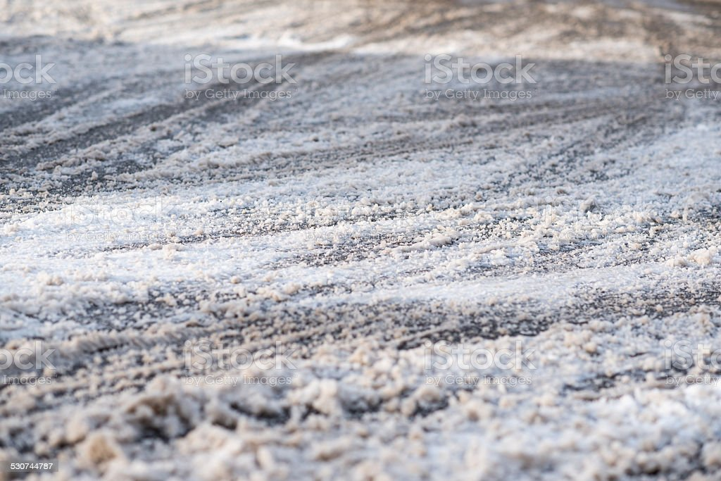 snow covered road with car tracks stock photo