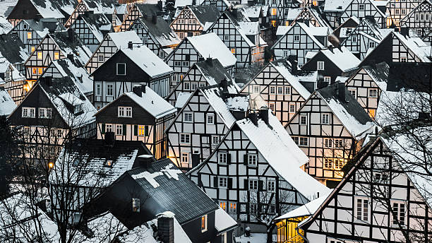 Snow covered roofs of half timbered houses stock photo