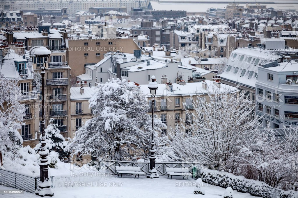 Snow covered rooftops in Paris stock photo