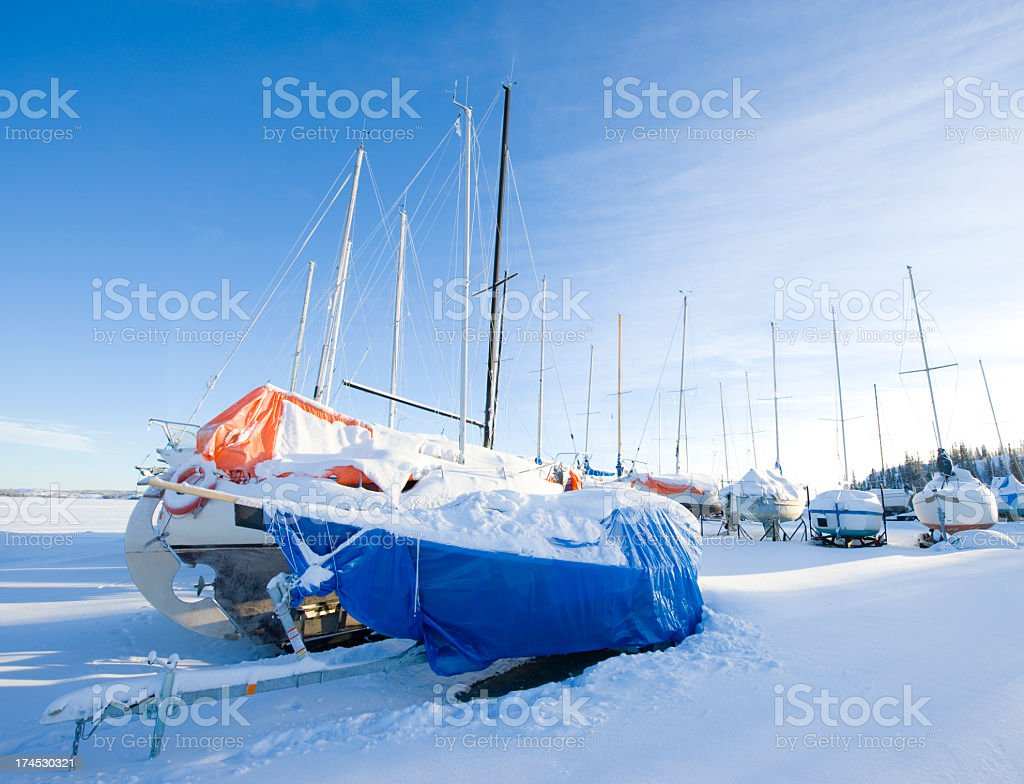 Snow Covered Sailboats Waiting For Spring, Yellowknife, Northwest Territories. royalty-free stock photo