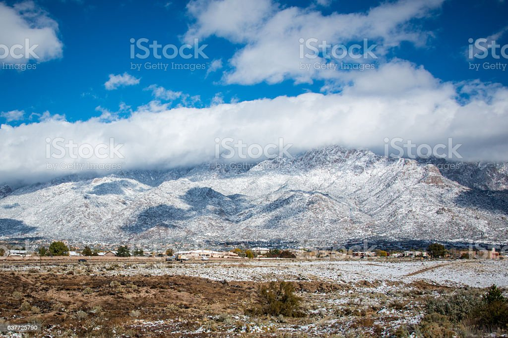 Snow Covered Sandia Mountains and Beautiful Sky, New Mexico stock photo