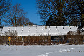 istock Snow covered solar panels on a bright and cold winter's day. 1291823195