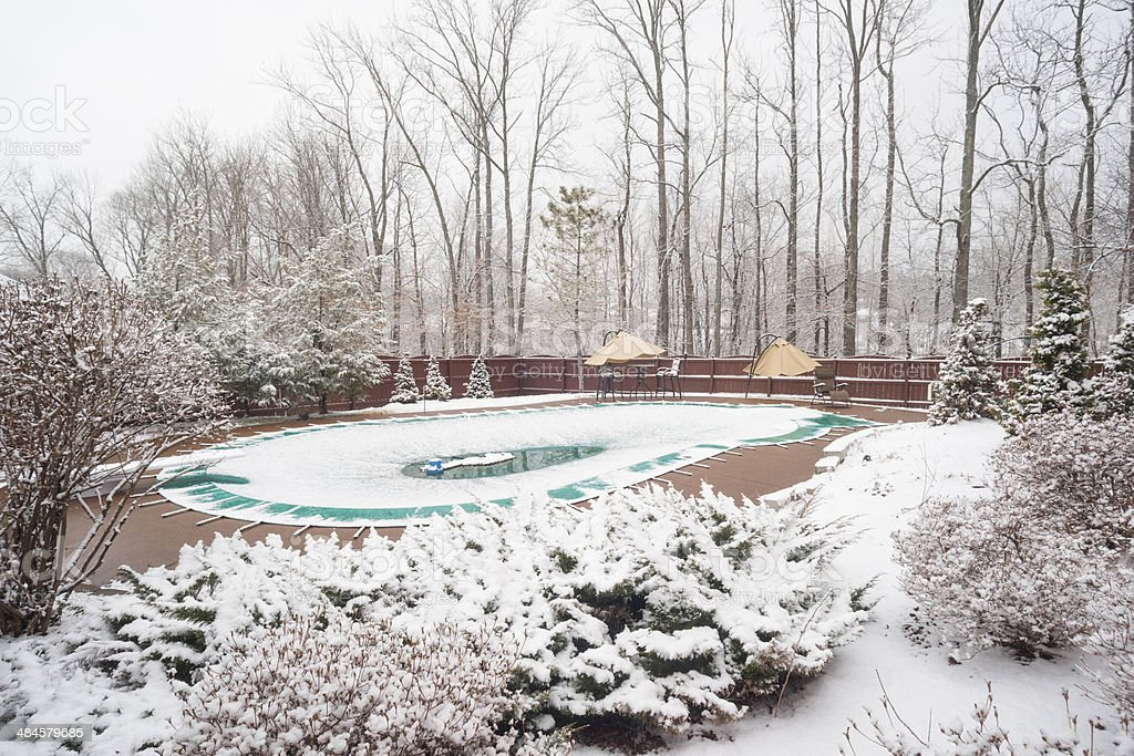 snow covered swimming pool stock photo