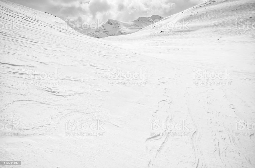 Snow covered valley and surrounding mountain peaks in Jotunheimen stock photo