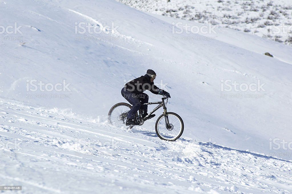 Snow downhill on bike royalty-free stock photo