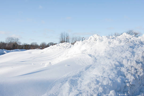 snow drift - snow pile stock photos and pictures
