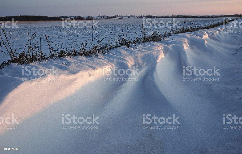 Snow Drifts at Sunset stock photo