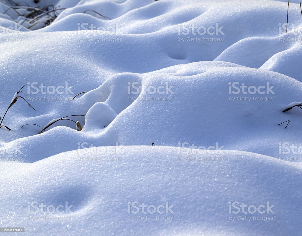 Snow drifts in snowbound winter meadow stock photo