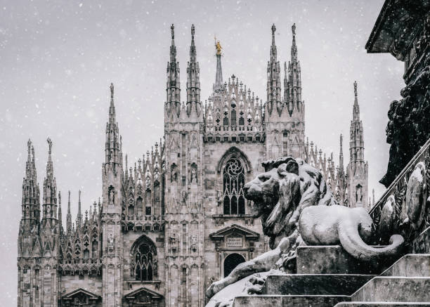Snow falling at Piazza del Duomo in Milan, Lombardy, Italy with Milan's landmark Cathedral in background stock photo