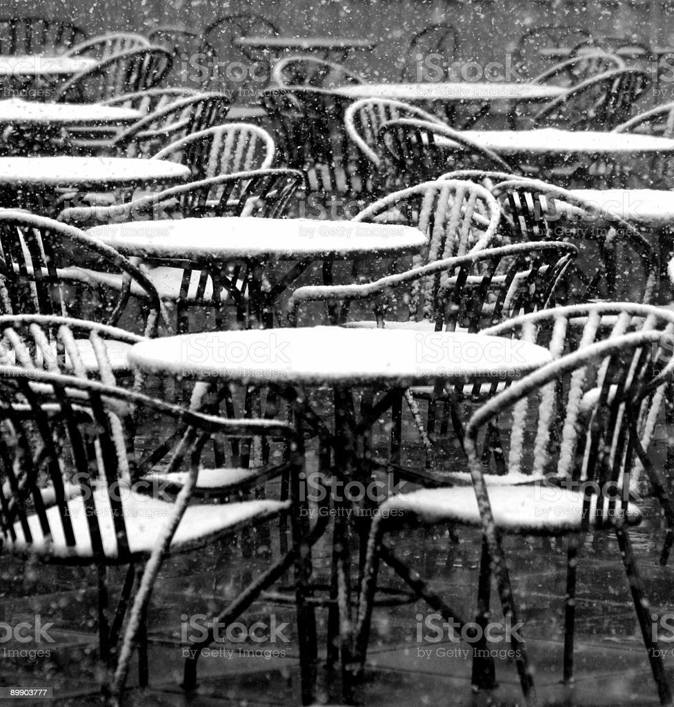 Snow falling on seats royalty-free stock photo