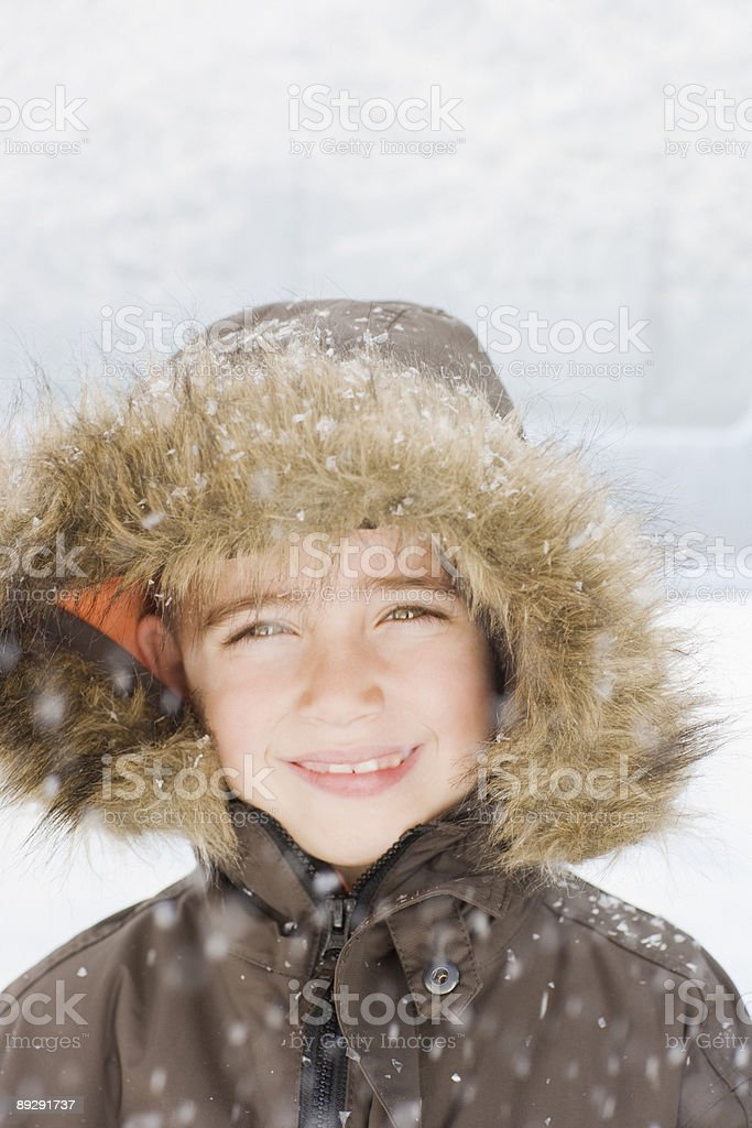 Snow falling on smiling boy royalty-free stock photo