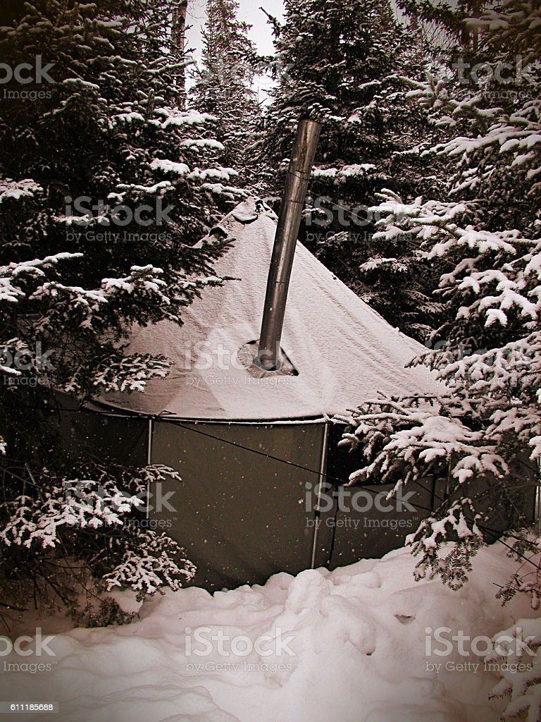 Snow Falls on Winter Camp with Vintage Effects stock photo