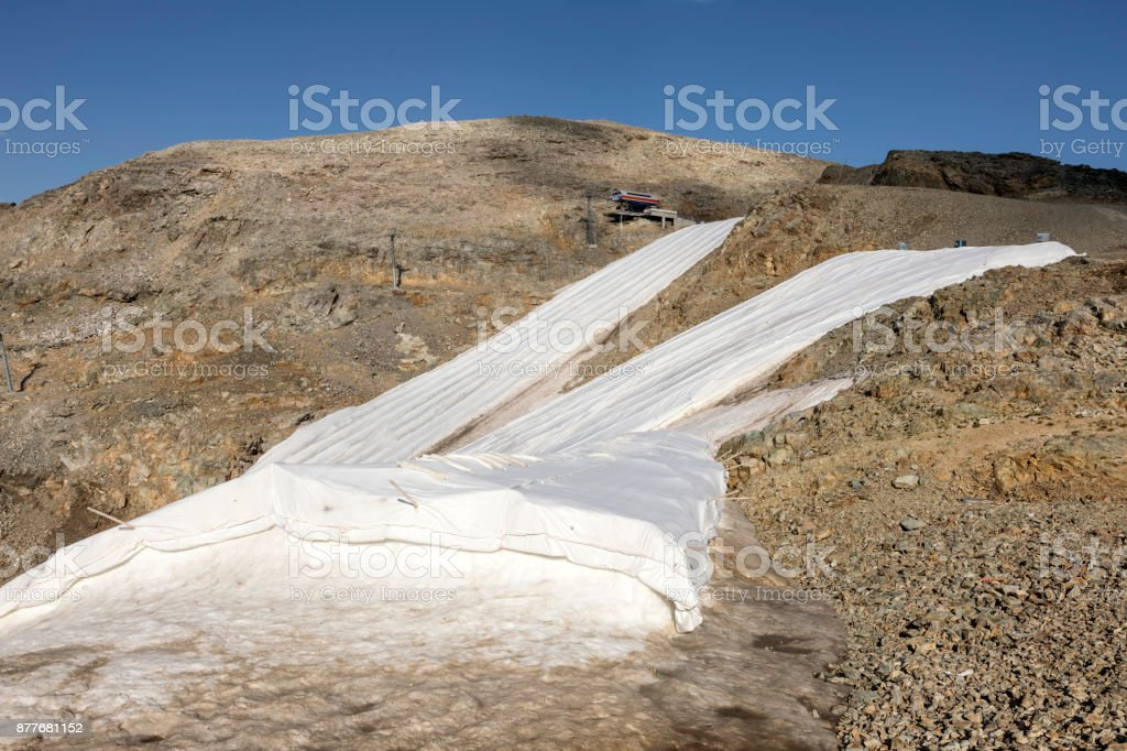 Snow farming on Diavolezza: Snow is covered with a flies against the melting, Switzerland stock photo