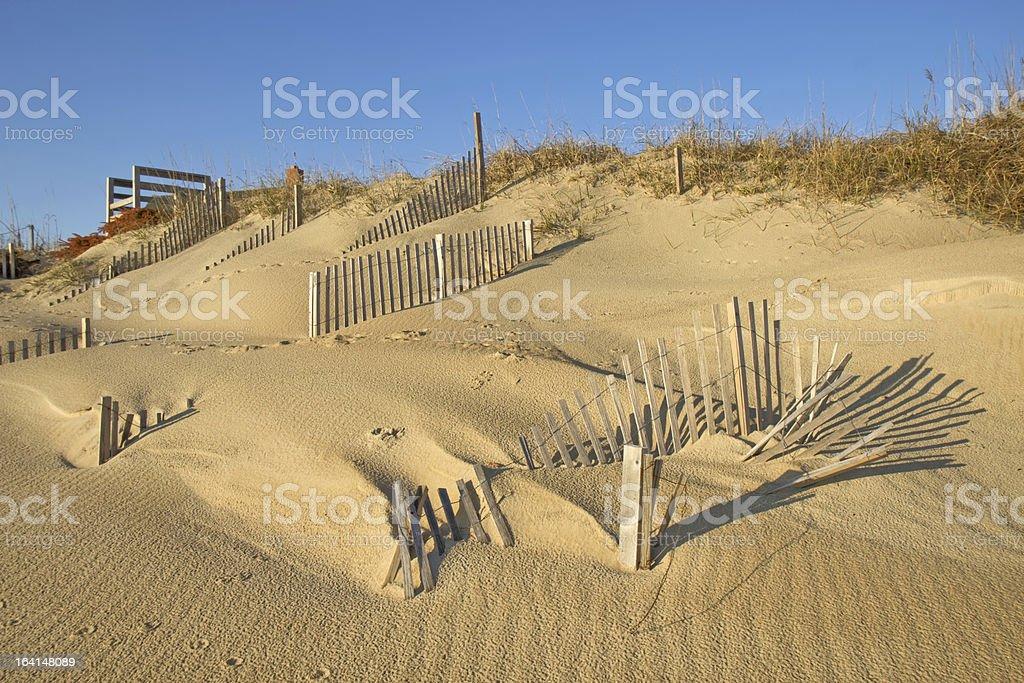 Snow fence on the beach at Nags Head, North Carolina royalty-free stock photo