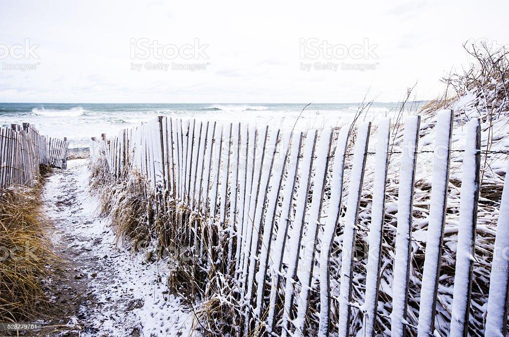 Snow fence path stock photo