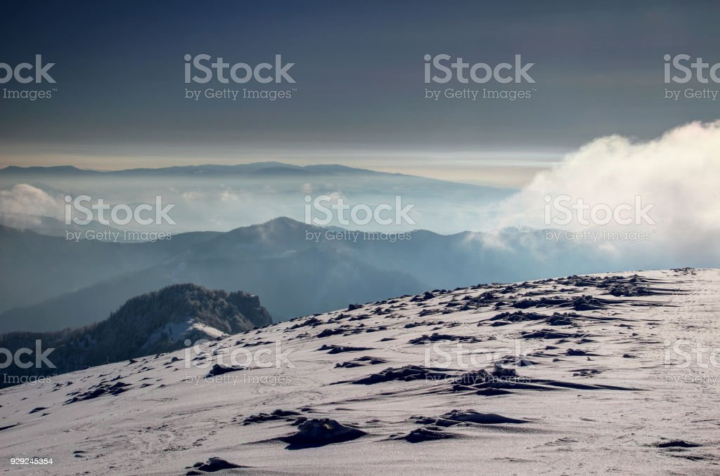 Snow formations on barren ridge in Velka Fatra above blue mist stock photo