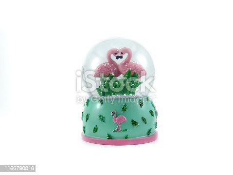 istock Snow globe Snowflake with flamingo and Love on stock photo 1166790816
