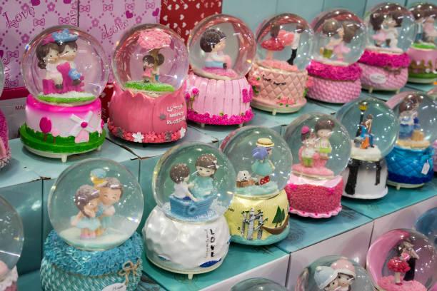 Snow Globes on market stall stock photo