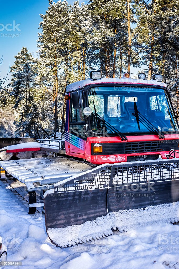 Snow Groomer in the forest stock photo