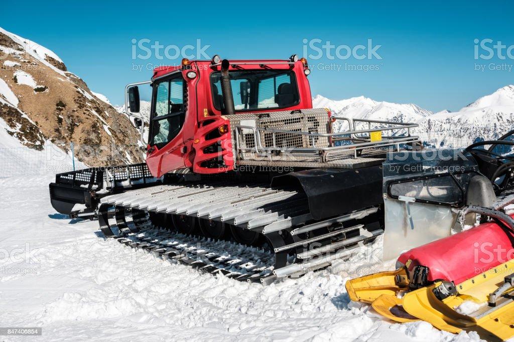 Snow grooming machine (Ratrak). Winter mountain landscape. stock photo