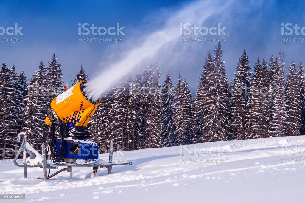 snow gun makes snow stock photo
