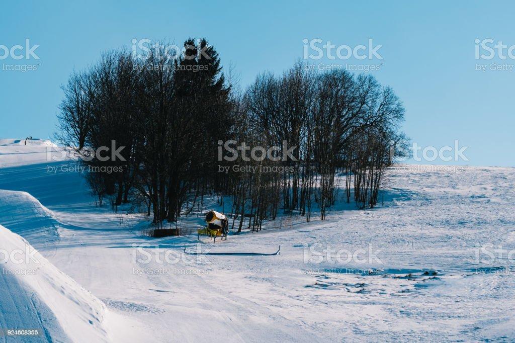 Snow gun on ski slope in the winter stock photo