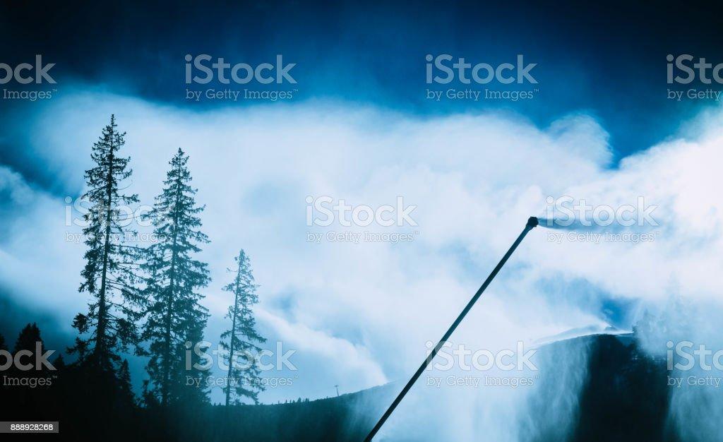 Snow gun, snow making process on a ski slope. stock photo