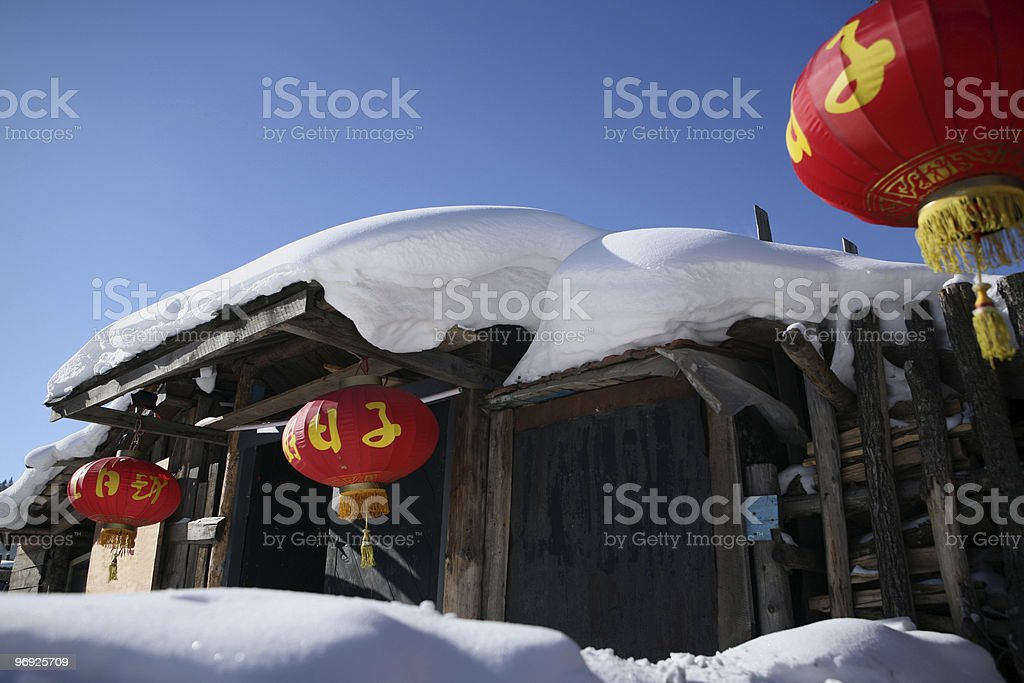 Snow house with red lanterns. royalty-free stock photo