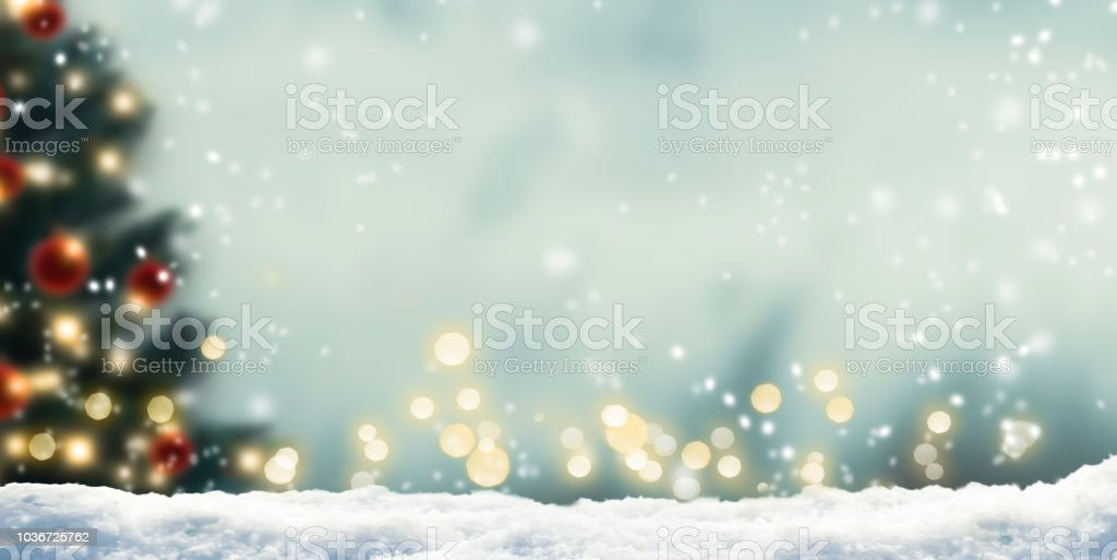 snow in front of wintery xmas background stock photo