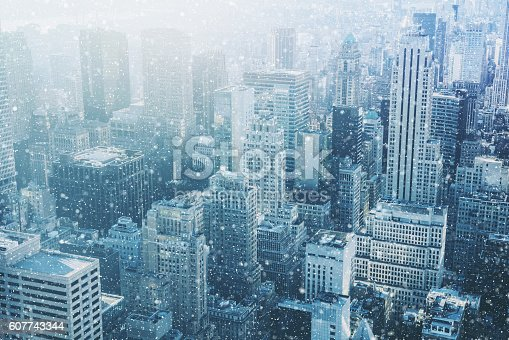 Snow in New York City - fantastic image,  skyline with urban skyscrapers in Manhattan, USA