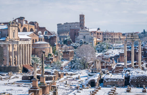Snow in Rome in February 2018, the Roman Forum with the Colosseum in the background as seen from Campidoglio, Rome, Italy. Snow in Rome in February 2018, the Roman Forum with the Colosseum in the background as seen from Campidoglio, Rome, Italy. roman forum stock pictures, royalty-free photos & images