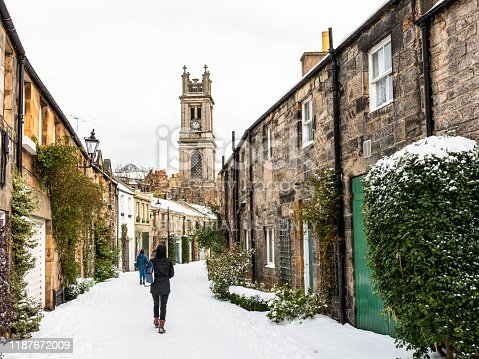 Edinburgh, Scotland - People walking along Circus Lane, a narrow, curving street in Edinburgh's Stockbridge district.