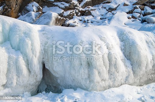 Snow island coast in winter. Winter mountain landscape