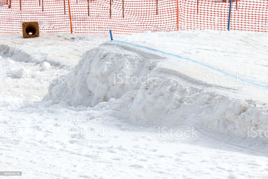 Snow jump at a skijoring competition stock photo