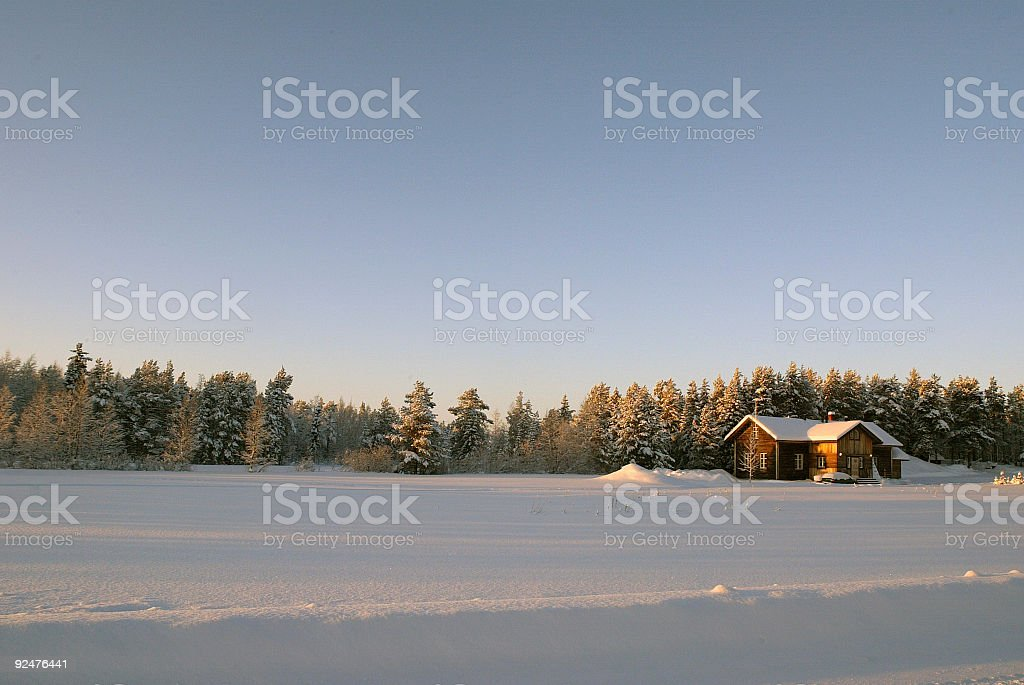 Snow Landscape with House in Lapland Finland royalty-free stock photo