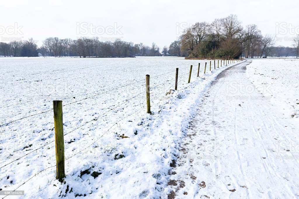 Snow landscape with path between meadows stock photo