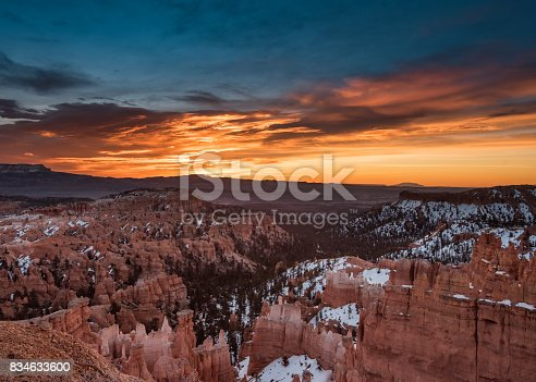 Snow Lingers on Bryce Canyon with Orange Sunrise Across Sky