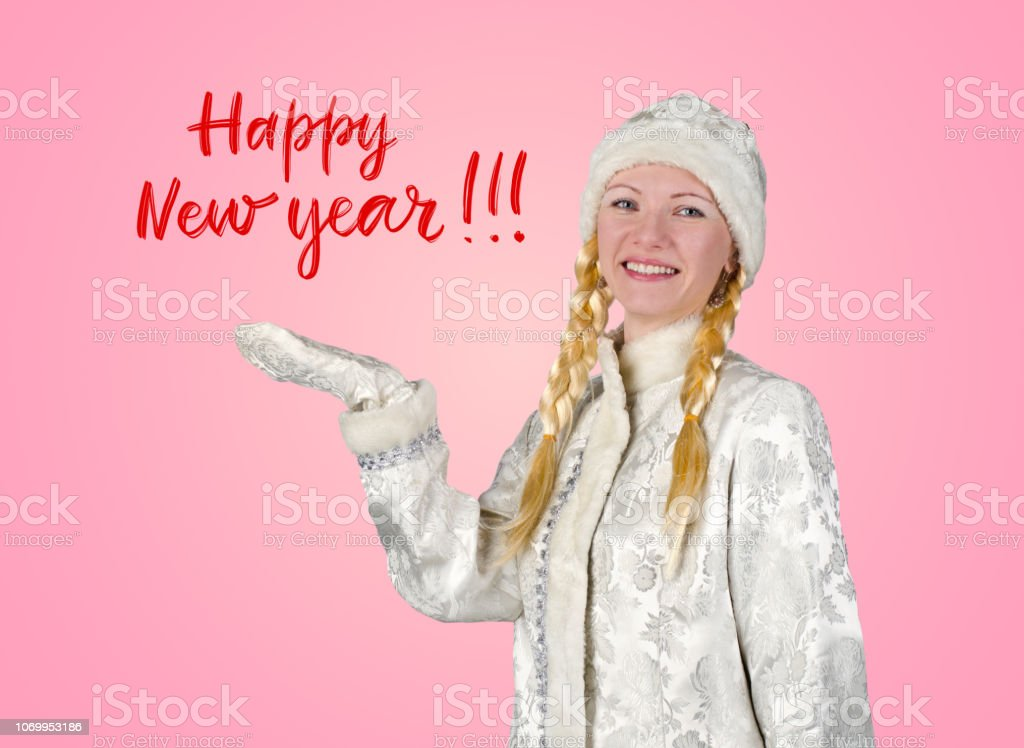 Snow maiden on a pink background with a congratulatory inscription stock photo