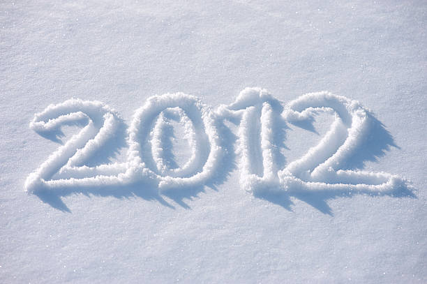 Snow Message 2012 Message handwritten in fresh powdery snow for 2012 2012 stock pictures, royalty-free photos & images