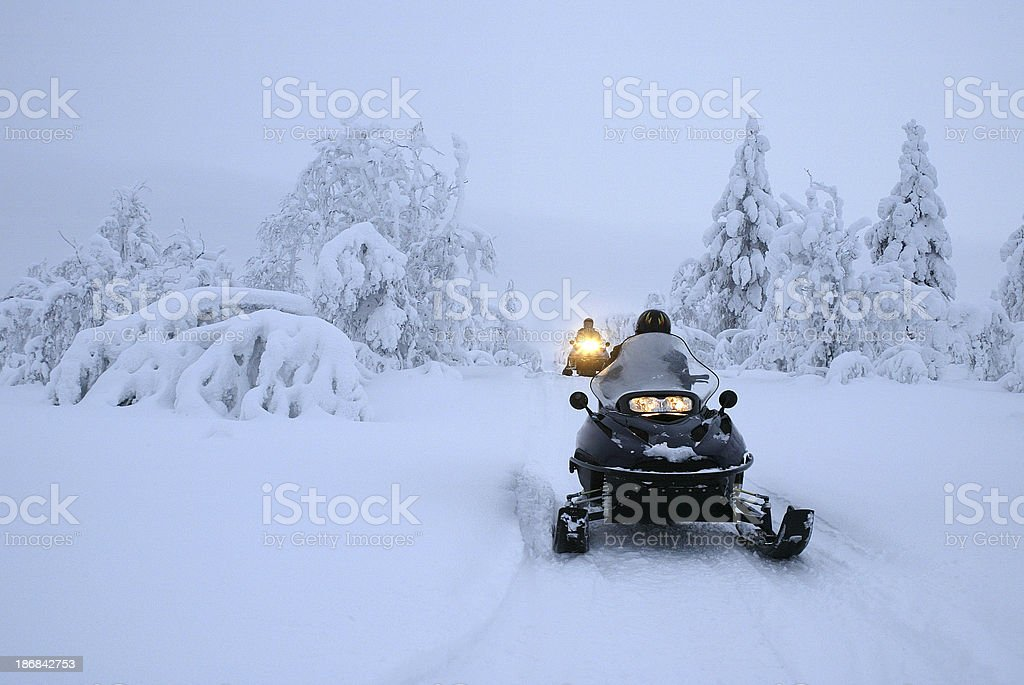 Snow Mobile Expedition Finland royalty-free stock photo