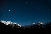 snow mountain with nice blue night sky with full of stars.