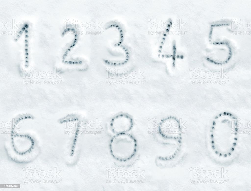 Snow numbers handwriting font royalty-free stock photo