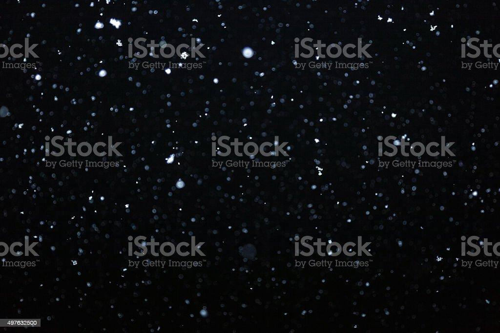 Snow on black background stock photo